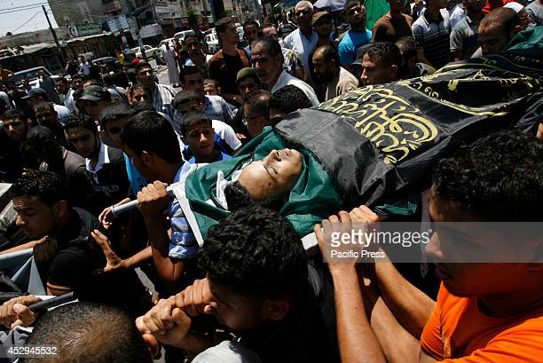 Relatives carry the body of a killed Palestinan during Israeli air strike Israel's bombardment of Gaza left dozens more Palestinians dead after a...