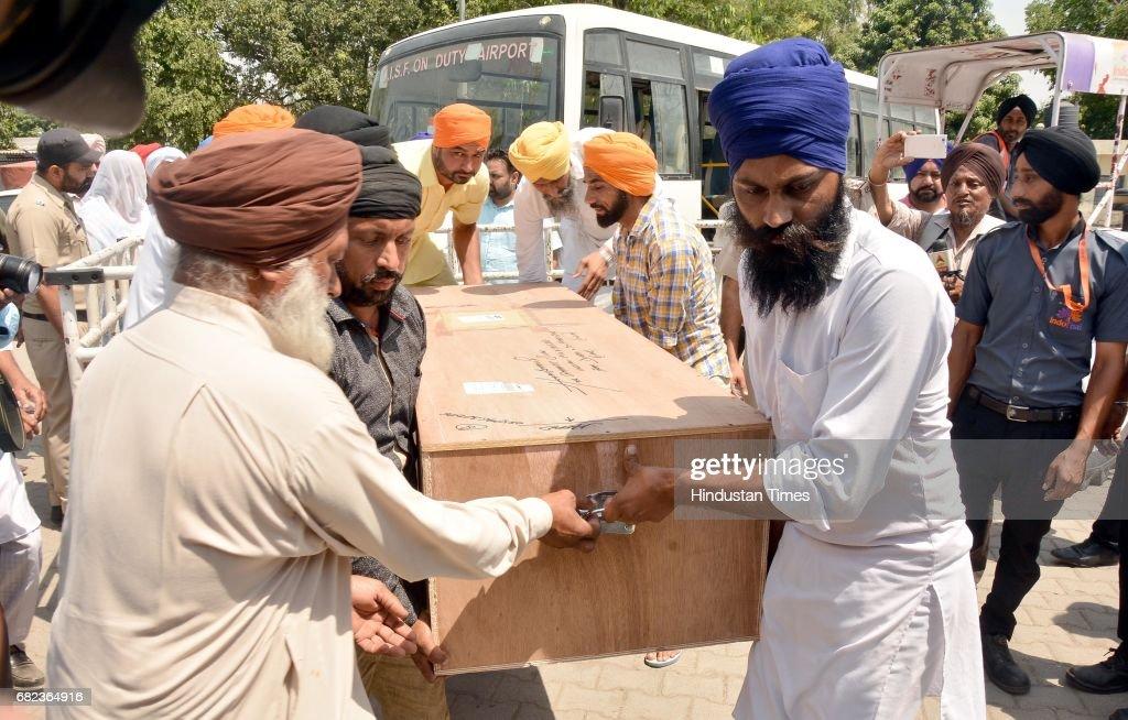 Relatives carry the coffin of Amarjit Singh resident of Bhamboi village district Gurdaspur at Sri Guru Ram Dass Jee International Airport on May 12...