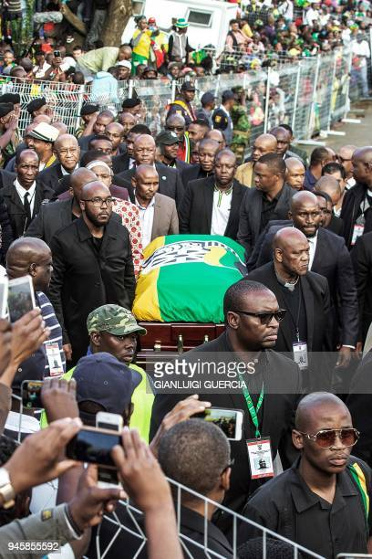 Relatives carry the coffin of Winnie Mandela late antiapartheid icon and exwife of former South African president Nelson Mandela at her house in...
