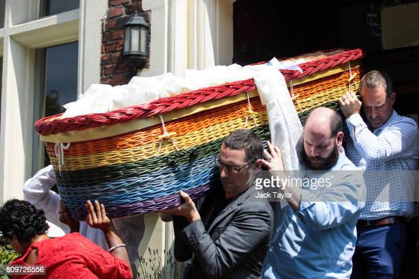 Relatives carry the willow eco coffin of Jon Underwood out of the Jamyang Buddhist Centre on July 6 2017 in London England The funeral of Jon...