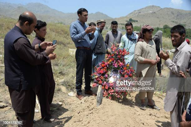 Relatives colleagues and friends of AFP driver Mohammad Akhtar pray at his burial ceremony in Kabul on July 23 a day after he was killed in a suicide...