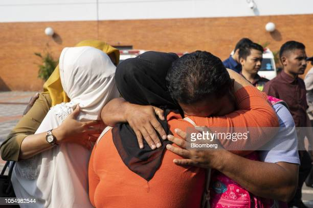 Relatives comfort each other at the crisis center at SoekarnoHatta International Airport in Cengkareng Jakarta Indonesia on Monday Oct 29 2018...