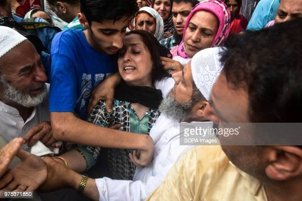 Relatives console the wife of Shujaat Bukhari veteran journalist and EditorinChief of English daily 'Rising Kashmir' during a funeral procession in...