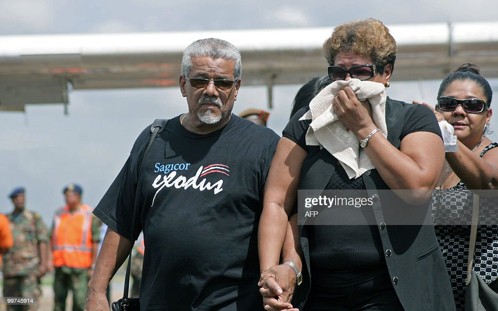 Relatives cry after rescue workers downloaded the remains of their beloved upon arrival at the Zorg en Hoop airport in Paramaribo on May 17, 2010. Eight people, including pilot and co-pilot, died in a plane crash on May 15 in the hinterlands of Suriname. This is the third accident, second with casualties, with an Antonov airplane of Blue Wing airline in two years in Surinam.