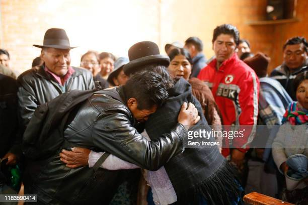 Relatives cry and mourn during the funeral of people killed yesterday during clashes between supporters of Evo Morales and security forces in the...