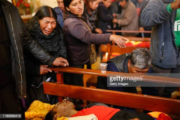 Relatives cry next to the coffin during the funeral of people killed yesterday during clashes between supporters of Evo Morales and security forces...