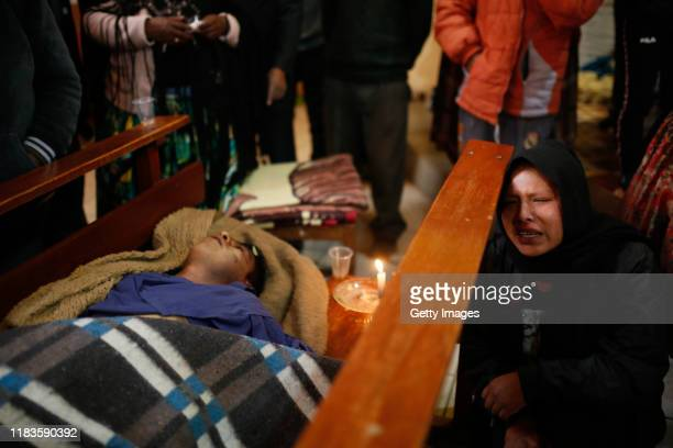 Relatives cry next to the coffins during the funeral of people killed yesterday during clashes between supporters of Evo Morales and security forces...