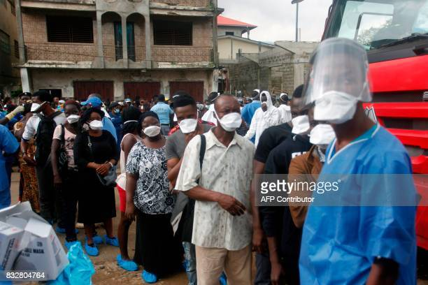 Relatives enquire on the fate of victims of the mudslide at the Freetown Morgue Sierra Leone on August 16 2017 Sierra Leone began a weeklong period...