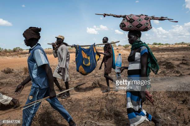 Relatives escort a Dinka woman affected by cholera to a temporary hospital in Mingkaman a camp for the Internally displaced people on April 26 in the...