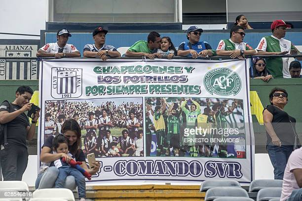 Relatives, friends and fans gather at the Alejandro Villanueva stadium in Lima on December 8, 2016 for a tribute to the footballers of Peru's Alianza...
