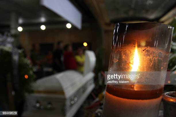 Relatives friends and supporters of journalists among 57 people massacred in the southern Philippine town of Ampatuan in Maguindanao attend a wake...