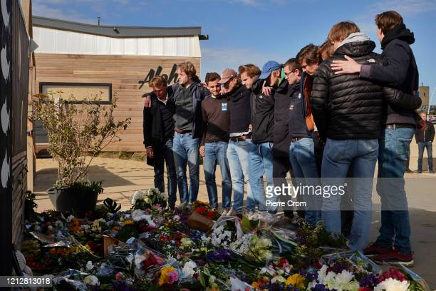 Relatives, friends and the surf community gather on The Hague Beach to mourn the loss of five surfers who drowned at sea a day prior on May 12, 2020...