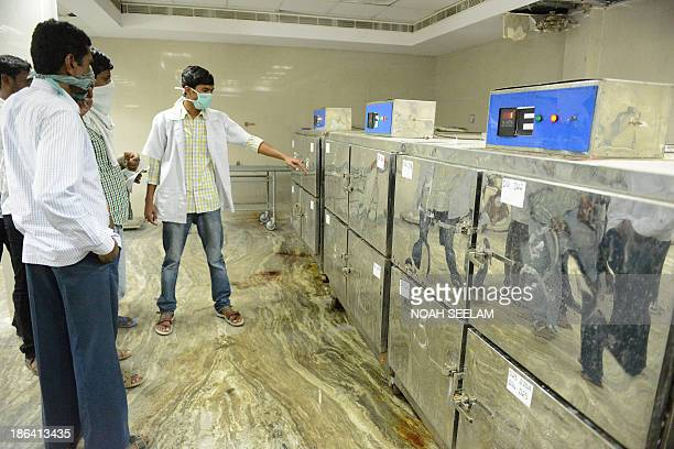 Relatives gather inside the mortuary of The Osmania General Hospital in Hyderabad on October 31 as they seek to identify the bodies of those killed...