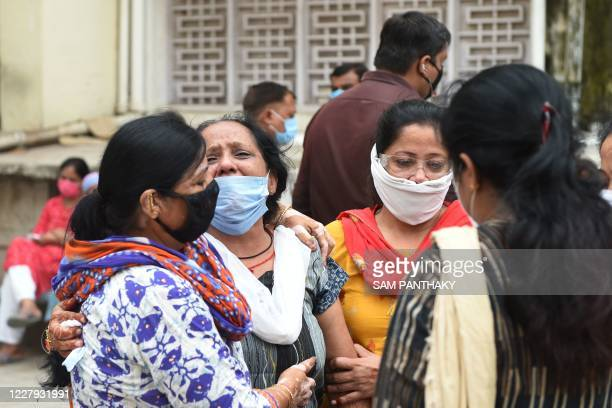 Relatives grief for their loved one outside the mortuary room of the Civil Hospital in Ahmedabad on August 6 after a fire broke early in the morning...