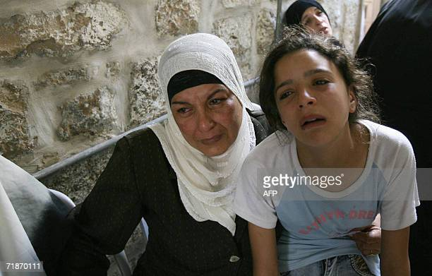 Relatives grieve during the funeral of Palestinian militant Ihab Abu Salha a member of the AlAqsa Martyrs Brigade the loosely affiliated armed wing...