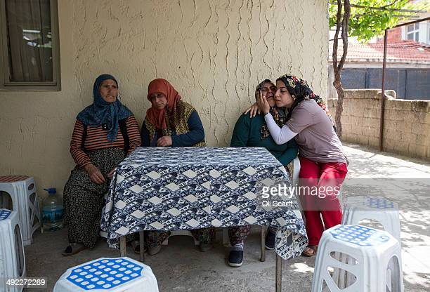 Relatives grieve for a mine worker who died in an explosion at Soma mine, at their home in the village of Avdan on May 19, 2014 near Soma, Turkey....