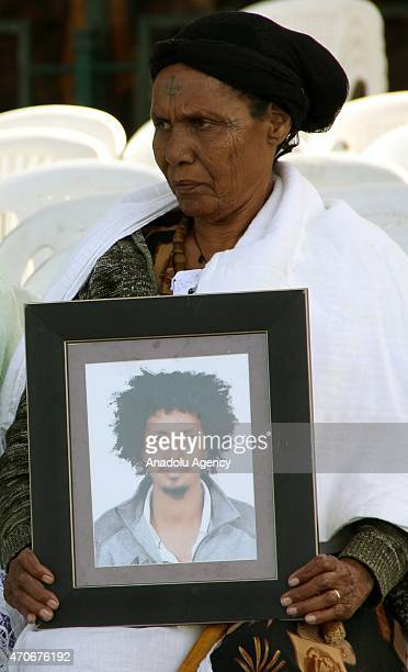 Relatives hold the pictures of 30 Ethiopians captured and killed by the Daesh militant group during a rally in Addis Ababa on April 22 2015 to...