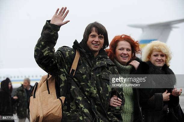 Relatives meet a sailor of the crew of the Ukrainian Faina ship captured by Somali pirates after the crew arrived home at Kiev airport on February 13...
