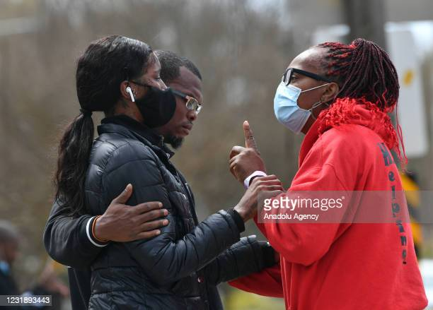 Relatives mourn after US Marshalls shot and killed a man who was a suspect at a gas station in Charlotte, North Carolina, United States on March 23,...