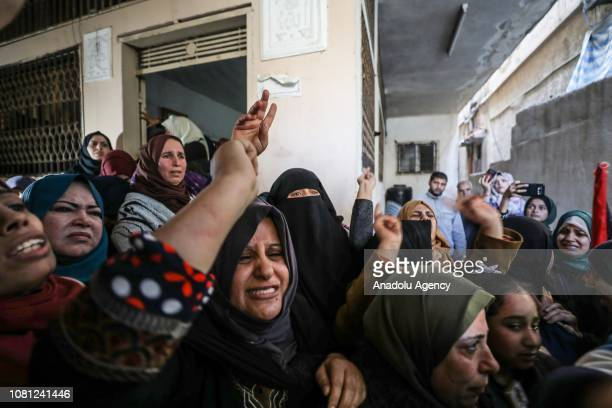 Relatives mourn during funeral ceremony of Palestinian woman Amal Mustafa Abu Sultan who was killed by Israeli army gunfire while taking part in...