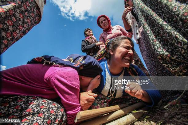 Relatives mourn during the funeral for the victims of a mining disaster on May 15, 2014 in Soma, a district in Turkey's western province of Manisa....