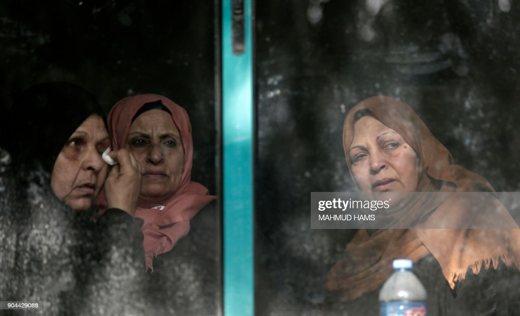 Relatives mourn during the funeral of Abdullah Zeidan, a 33-year-old fisherman, in Gaza City on January 13, 2018. A fisherman from the Gaza Strip was shot dead by the Egyptian army overnight for unclear reasons, Palestinian officials said Saturday, calling for an immediate investigation into the incident. /