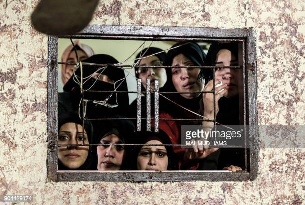 TOPSHOT Relatives mourn during the funeral of Abdullah Zeidan a 33yearold fisherman in Gaza City on January 13 2018 A fisherman from the Gaza Strip...