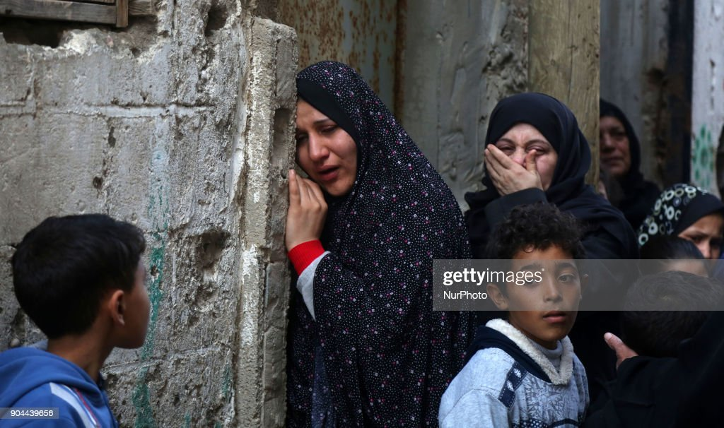 Relatives mourn during the funeral of Abdullah Zeidan, a 33-year-old fisherman, in Gaza City on January 13, 2018. A fisherman from the Gaza Strip was shot dead by the Egyptian army overnight for unclear reasons, Palestinian officials said Saturday, calling for an immediate investigation into the incident.