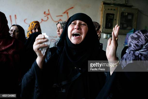 Relatives mourn during the funeral of at least 9 members of the same al-Ghul family who died after their house was hit by an Israeli air strike in...
