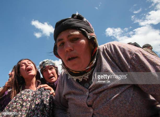 Relatives mourn during the funeral of the miners after a mining disaster on May 15, 2014 in Soma, a district in Turkey's western province of Manisa....