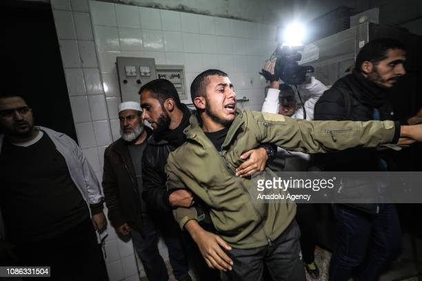 Relatives mourn for Mahmoud Abed alNabahin who was killed by Israeli army at the morgue of Al Aqsa hospital in Deir Al Balah Gaza on January 22 2019