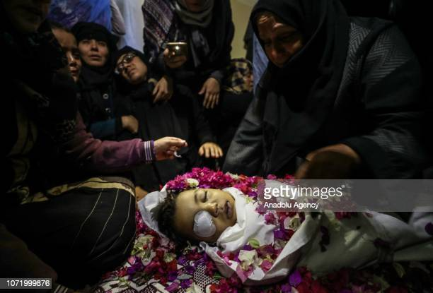 Relatives mourn for Palestinian 4yearold Ahmed Yassir Sabri Abu Abid who wounded and lost his life after Israeli army intervened in a 'Great March of...