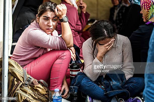 Relatives mourn in an area allocted for families outside a forensic morgue as they wait for the body of a relative on October 11 2015 in AnkaraTurkey...