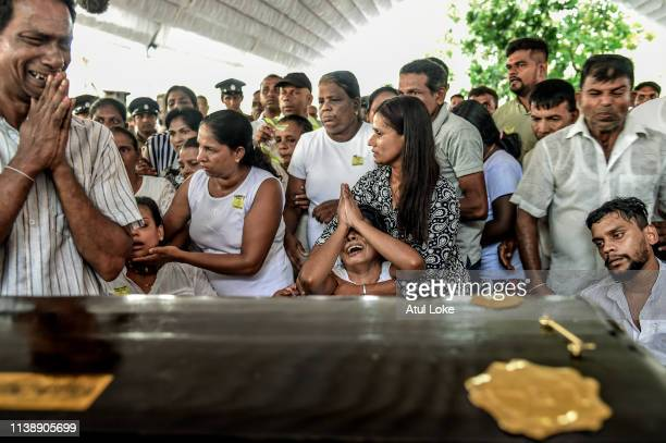 Relatives mourn in front of the coffin at St Sebastian's Church on April 23 2019 in Negombo Sri Lanka At least 311 people were killed with hundreds...
