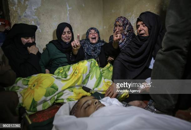 Relatives mourn near the dead body of Palestinian Said Muhammed Vehbe who was killed by Israel forces during peaceful border demonstrations Great...