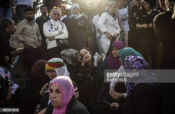 Relatives mourn near the grave of a victim of the twin bombings in Ankara, during the funeral in Istanbul on October 12, 2015. Turkey woke in...