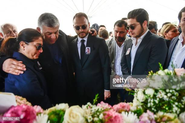 Relatives mourn next to the coffin of Mina Basaran of the victims of a a plane crash over Iran on March 15 2018 during her funeral cerenomy in...