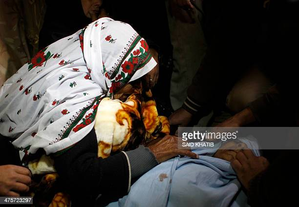 Relatives mourn over the body of Amena Atiyyeh Qdeih a mentally ill Gazan woman who was shot dead by Israeli troops near the border early on March 1...
