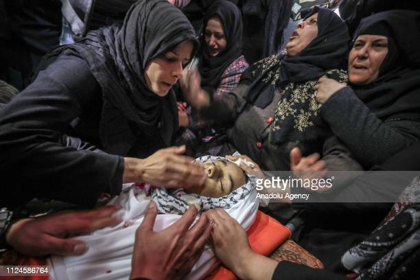 Relatives mourn over the body of Hassan Nabil Nofal who was hit in the head by an Israeli teargas bomb last Friday in the Bureij refugee camp and...