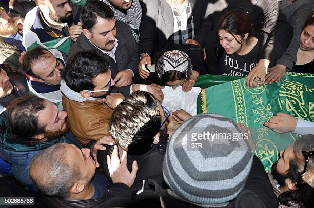 Relatives mourn over the coffin of film maker Naji Jerf in Gaziantep on December 28 2015 Naji Jerf a Syrian activist who produced documentaries...