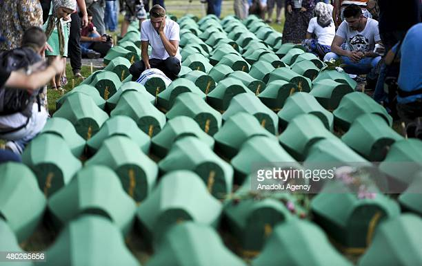Relatives mourn over the coffins of the victims of Srebrenica massacre on July 10 ahead of the mass burial of 136 victims on the 20th anniversary of...