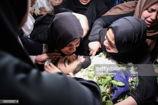 Relatives mourn over the dead body of Ahmed Ibrahim Zaki alTaweel who was killed after Israeli soldiers intervened in 'Great March of Return'...