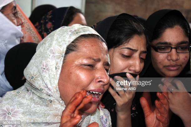 Relatives mourn shooting victim Sarfaraz Shah during his funeral in Karachi on June 9 after he was soldiers Pakistani authorities have arrested five...