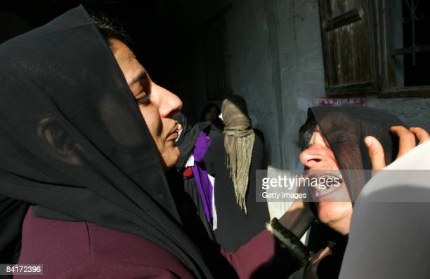 Relatives mourn the death of 20yearold Mohamad Abo Shaar during his funeral who was killed during an overnight Israeli airstrike on January 5 2009 in...