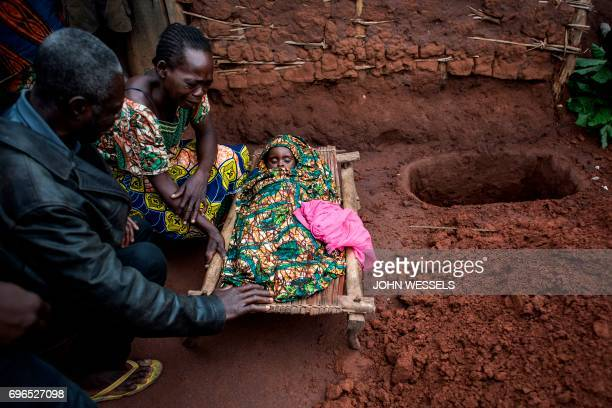 TOPSHOT Relatives mourn the death of a fifteen month old baby after she passed away as an outbreak of malaria hit their village on June 13 2017 in...