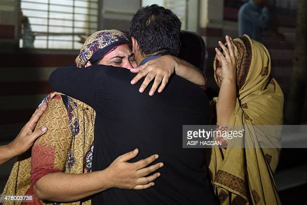 Relatives mourn the death of a heatwave victim at the EDHI morgue in Karachi on June 21 2015 A heatwave has killed at least 45 people in Pakistan's...