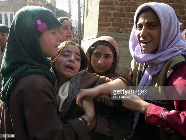 Relatives mourn the death of Bilal Ahmed Paul a student who was shot dead by the police along with two other youths November 19 2001 in Batapora...