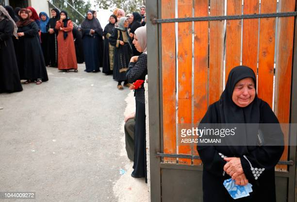 Relatives mourn the death of Mohammed Remawi Khatib during his funeral in the northern West Bank village of Beit Rima near Ramallah on October 1 2018...