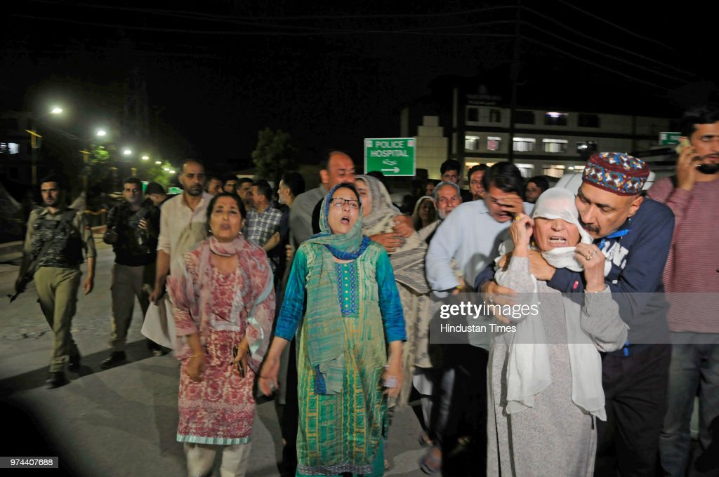 Relatives mourn the death of senior journalist Shujaat Bukhari outside Police Control Room on June 14, 2018 in Srinagar, India. Bukhari was in his vehicle outside his office at Press Enclave when he came under fire. Two of his personal security officers were also injured in the attack.