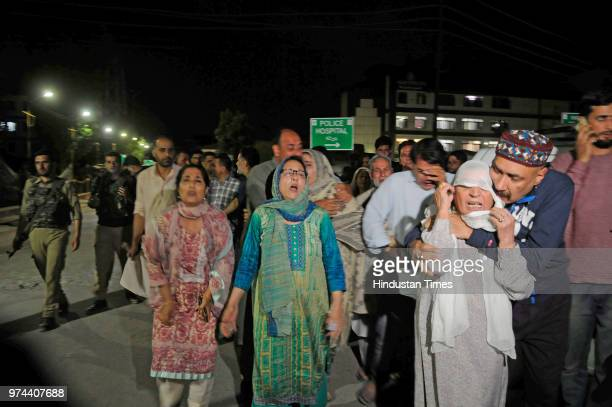 Relatives mourn the death of senior journalist Shujaat Bukhari outside Police Control Room on June 14 2018 in Srinagar India Bukhari was in his...